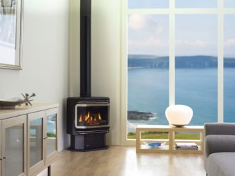 Ultimate U38/U39 black wood stove in living room corner